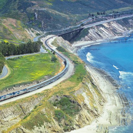 An Amtrak superliner traveling along the Pacific coastal region.